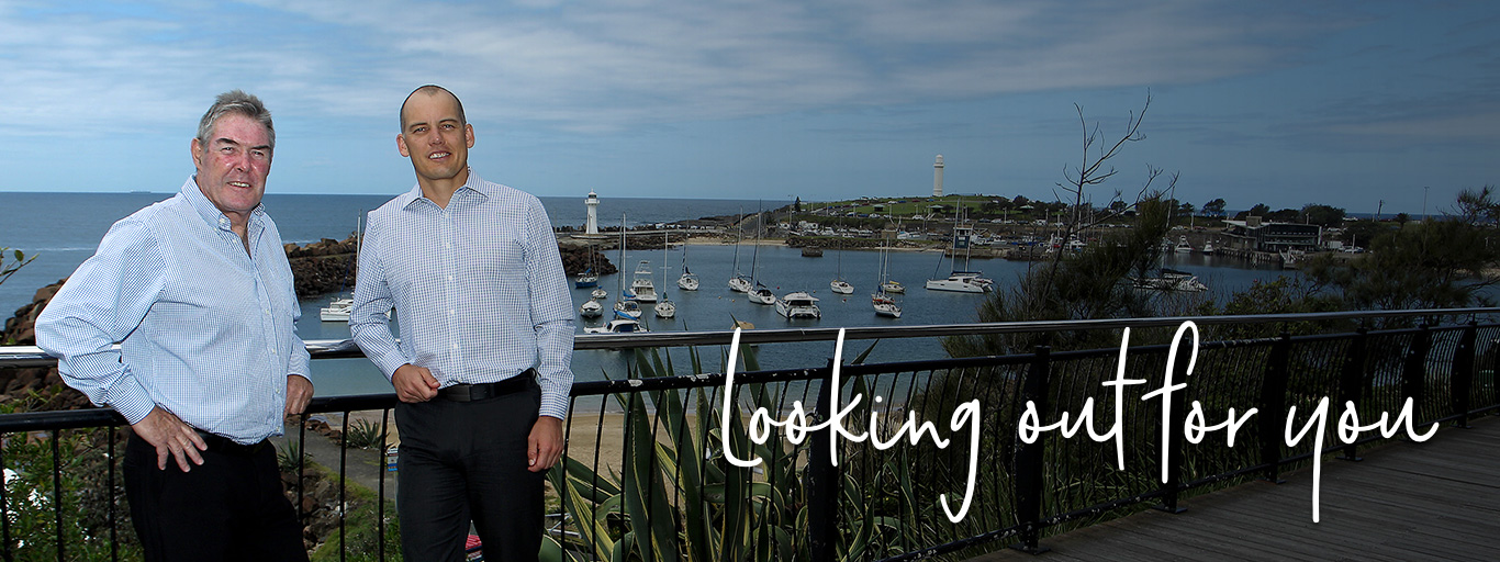 Greg and Jye standing with Wollongong harbour in the background