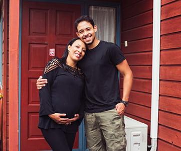 image of couple standing near front door