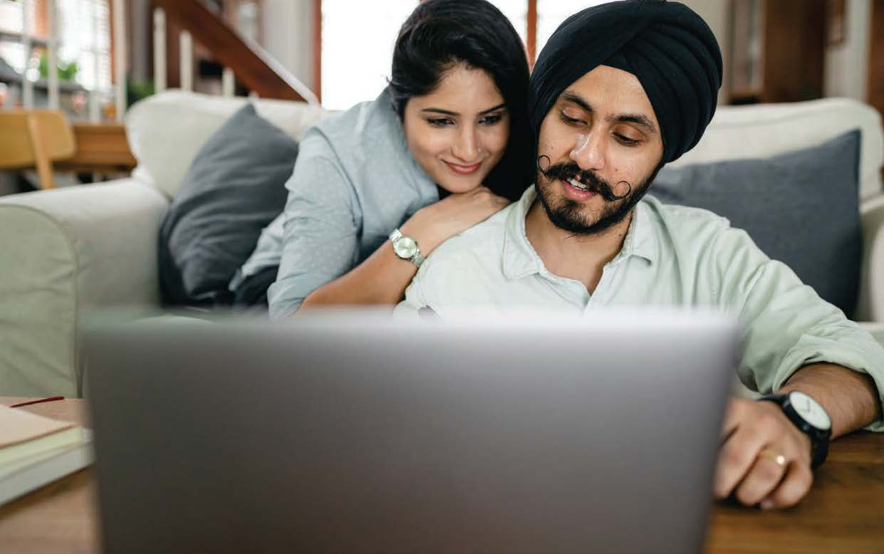Image of a couple looking a a computer